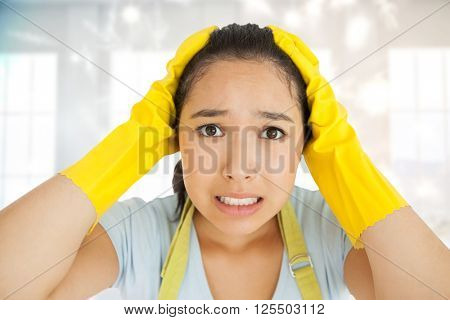 Stressed out woman against twinkling lights over room with windows