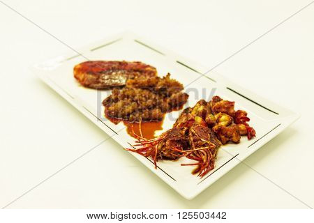 Fried tiger prawns and octopus in a Chinese style grilled barbecue in a spicy oil