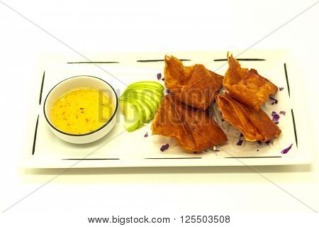 Appetizing Chinese fried pancakes with vegetables with sweet-sour sauce