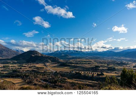 Epic mountain valley landscape. Aerial scenic valley view from Crown Range road Queenstown New Zealand. Mountain road to Queenstown. Beautiful mountain landscape