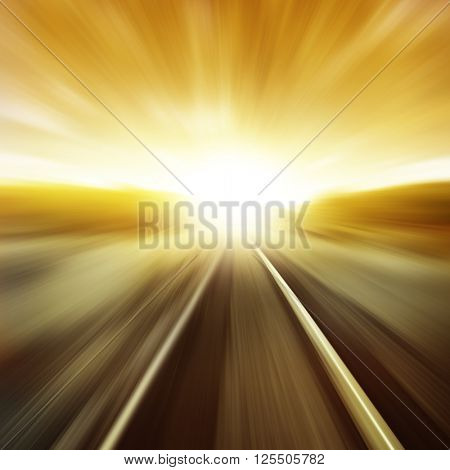 Toned image of railway in motion blur at sunset.