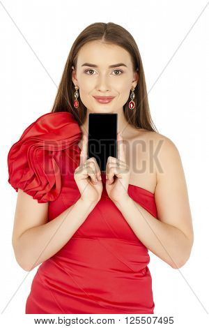 Sexy brunette showing smart phone. Young woman in red dress isolated on white background