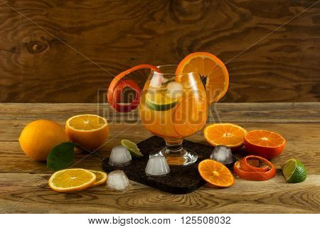 Citrus lemonade on wooden background. Fruit cocktail. Fruit drink. Fruit juice. Fruit lemonade. Summer drink