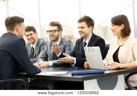 Group of business partners discussing ideas at meeting in office