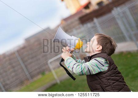 Little Boy Screaming Through A Megaphone