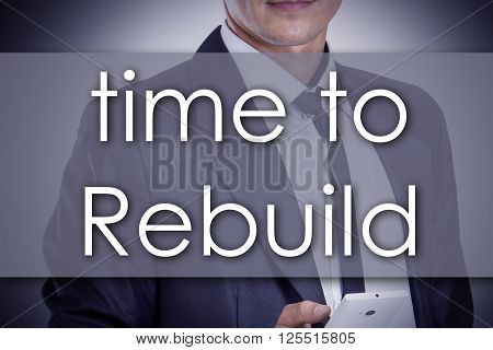 Time To Rebuild - Young Businessman With Text - Business Concept