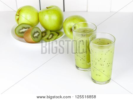 Healthy Green Smoothie Apple And Kiwi On White Table