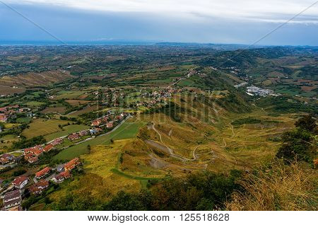 Aerial view of countryside of Rimini Italy and San Marino from Monte Titano Titan Mountain. Nature agriculture landscape aerial view