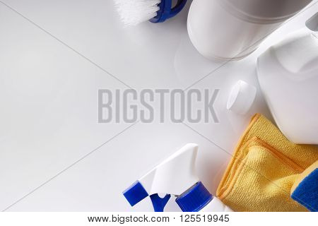 Professional Cleaning Equipment On White Table Top View