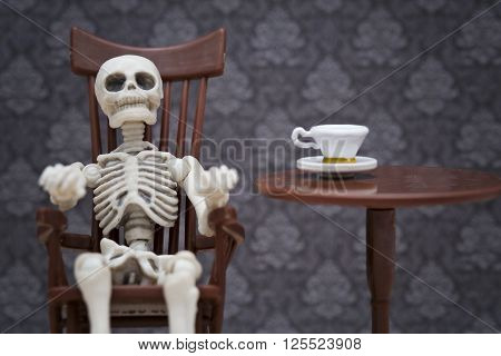 a skeleton sitting on a rocking chair
