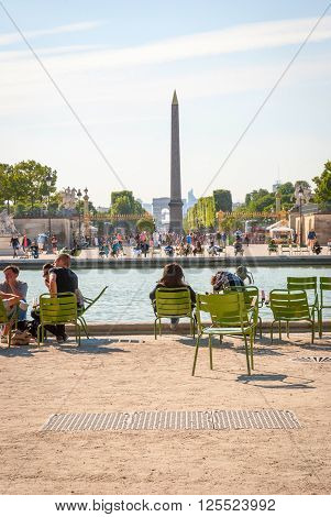 People Relaxing In Park De Tuileries, Paris