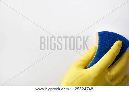 Hand With Yellow Glove With Scourer Background