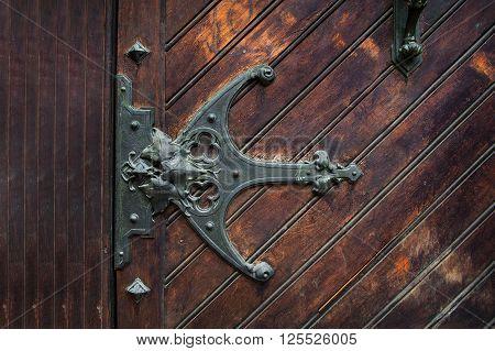 element of metal sheds on the wooden door.