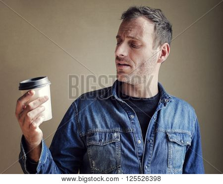 Man with take away cappuccino