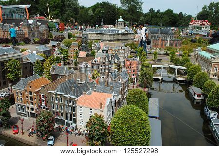 THE HAGUE, THE NETHERLANDS, July 5: Tourists are wandering around in Madurodam, a miniature park with scale model replicas of Dutch buildings and a popular tourist attraction in the Netherlands on July 5, 2012