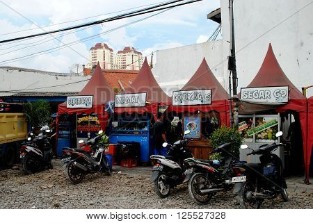 JAKARTA, INDONESIA, DECEMBER 15: Small shops selling food and drinks in Kota, the old town of Jakarta, on December 15, 2014.