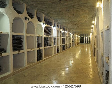 Moldova Cricova. 3october.2015.  Big underground wine cellar with collection of bottles in niches