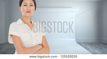 Business colleagues with arms crossed in office against large white screen