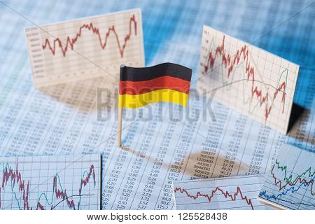 German flag with rate tables and graphs for economic development.