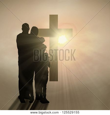 Happy family embracing each other over against dark background