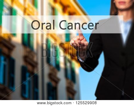 Oral Cancer - Businesswoman Hand Pressing Button On Touch Screen Interface.