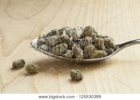 Salted capers on a spoon