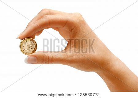 Womens hand holding a coin one euro on white background. Business concept