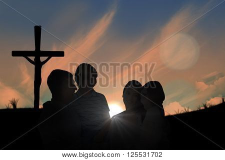 Mother and father carrying children over white background against cross religion symbol shape over sunset sky