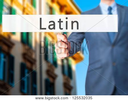 Latin - Businessman Hand Holding Sign