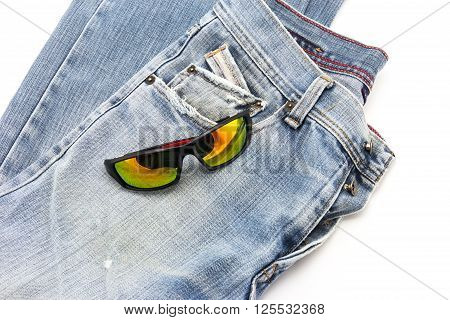Close up sun glasses on blue jeans background
