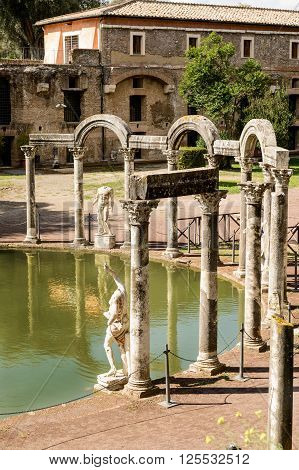 Ancient ruins of Villa Adriana(Canopus canal pool surrounded by columns and statues) Tivoli Italy