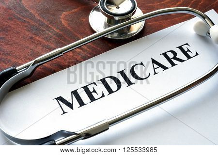 Word medicare written on a paper and stethoscope.