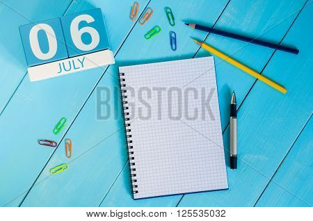 July 6th. Image of july 6 wooden color calendar on blue background. Summer day. Empty space for text. World International Kiss or Kissing Day.