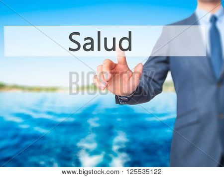 Salud - Businessman Hand Pressing Button On Touch Screen Interface.