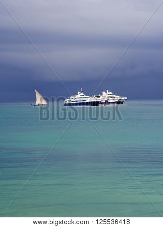 STONE TOWN ZANZIBAR - APRIL 02 2016: Boats close to Zanzibar on the Indian Ocean right before a storm. Heavy clouds in the background.