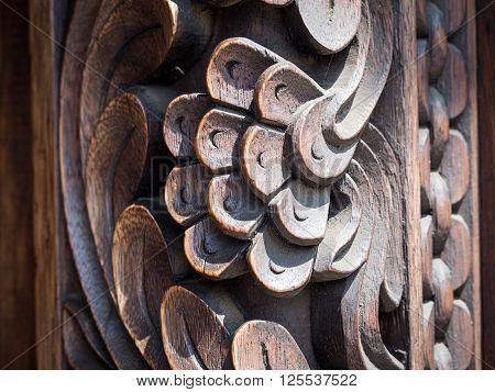 Horizontal close up photo of typical carved decorations with floral motives of an old traditional wooden door in Stone Town Zanzibar Tanzania East Africa. Background.
