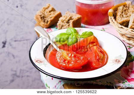 Homemade canned tomatoes in their own juice. Selective focus.
