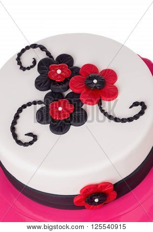 Gothic cake from sugar pastes red flowers. On birthday.