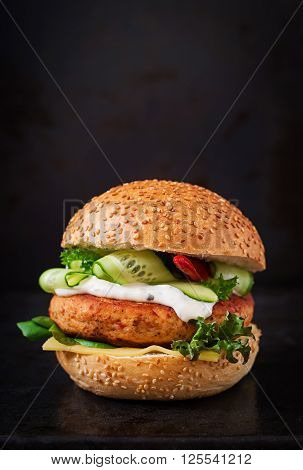 Big Sandwich - Hamburger With Juicy Chicken Burger, Cheese, Cucumber, Chili And Tartar Sauce On Blac