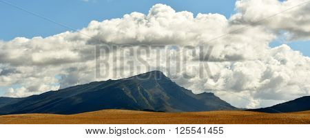 Landscape with Mountain and white clouds in the sky