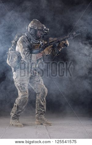 Us Army Soldier In Action With Goggles In The Smoke