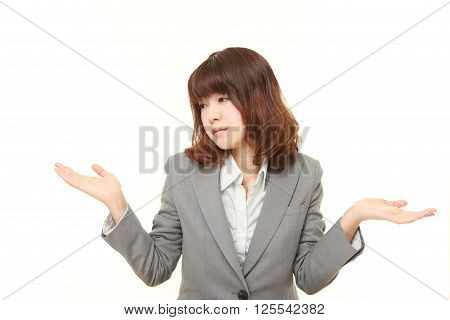 studio shot of Japanese businesswoman confused on white background