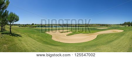 View golf course in the summer. With sand traps.