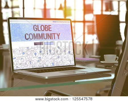 Globe Community Concept. Closeup Landing Page on Laptop Screen in Doodle Design Style. On Background of Comfortable Working Place in Modern Office. Blurred, Toned Image. 3D Render.