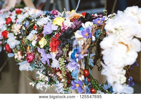 Many color wreathes on head with flowers