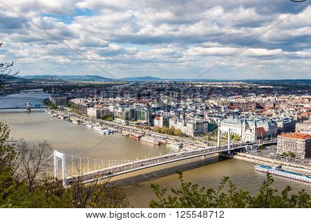 Peautiful panorama of Budapest city with Danube river, bridges and boats, Hungary. Cityscape with blue sky and gorgeous clouds.