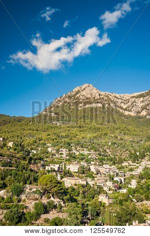 Beautiful view of a small mountain village Deia in Mallorca, Spain. Houses built on hills in Deia mountain village in Majorca island, Spain.