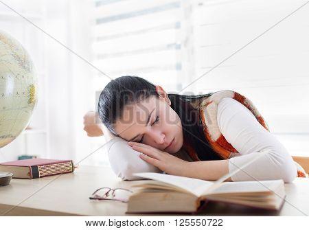 Student Girl Sleeping Over Books At Desk