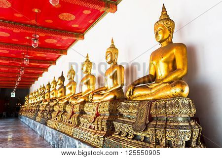 Bangkok, Thailand. Golden Buddha Array In The Temple Of Wat Pho