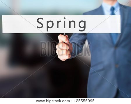 Spring - Businessman Hand Holding Sign